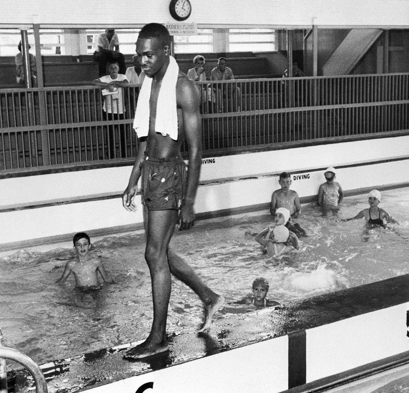 An image of David Isom walking into a pool full of whites